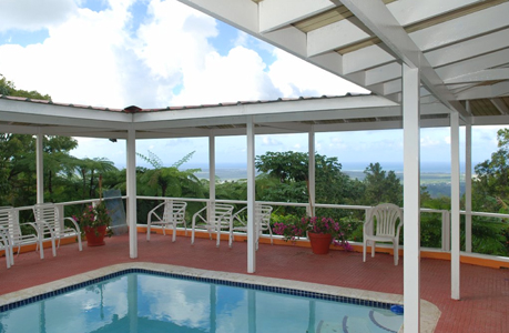pool area with covered deck at the villa rental