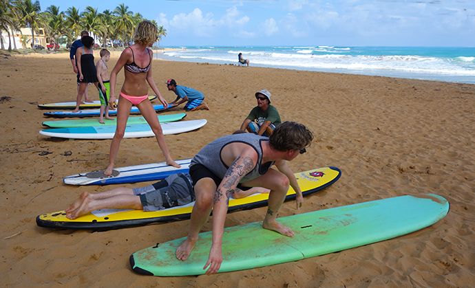 Guide instructors given surfing lessons