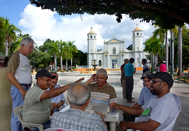 Playing dominos on the plaza in Guayama